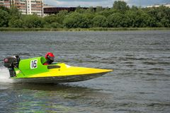 Racer in speed boat go fast along the river royalty free stock photo