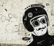 Racer. Symbolic image of the rider's head in the old helmet Royalty Free Stock Photography