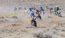 Racers Corning on Dirt Bikes Royalty Free Stock Photos