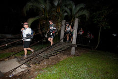Racers crosses the river at starting point. Stock Images
