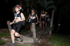 Racers crosses the river at starting point. Royalty Free Stock Photography