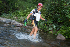 Racers makes  way across a river in the morning Royalty Free Stock Photo