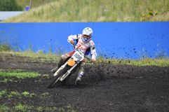 Racers on motorcycles participate in cross-country race competit Royalty Free Stock Images