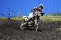 Racers on motorcycles participate in cross-country race competit Stock Image