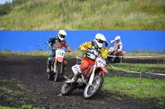 Racers on motorcycles participate in cross-country race competit Stock Photo