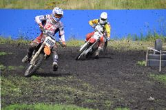 Racers on motorcycles participate in cross-country race competit Stock Photography