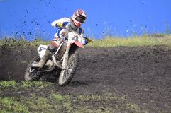 Racers on motorcycles participate in cross-country race competit Stock Images