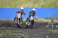 Racers on motorcycles participate in cross-country race competit Royalty Free Stock Photos