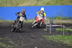 Racers on motorcycles participate in cross-country race competit Royalty Free Stock Image