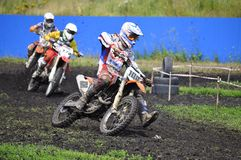 Racers on motorcycles participate in cross-country race competit Royalty Free Stock Photography