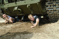 Racers move under tank in extrim race. Tyumen Stock Photography