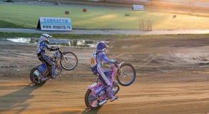 Races on back wheels. Vladivostok, Primorsky Region, Russia - October 10th, 2015: Vladivostok, Avangard stadium, speedway races Big Vladivostok, on a photo of Stock Photos