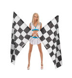 Races. Cute blonde posing with two checkered flags Royalty Free Stock Photography