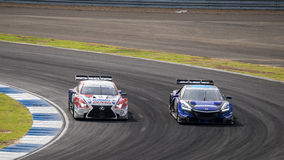 Races Dual Battle DENSO KOBELCO SARD RC F GT500 with RAYBRIG NSX Stock Photography