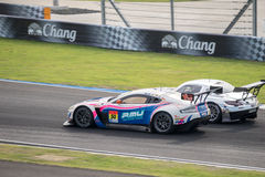 Races Dual Battle WAKO'S Exe Aston Martin GT300 with GREENTEC SL Royalty Free Stock Photography