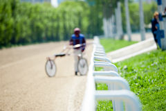 The racetrack blurry background in sunny day Stock Image