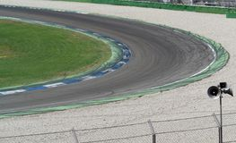 Racetrack curve. Curve scenery on a racetrack named Hockenheimring in Southern Germany with wheel traces and run-off area Royalty Free Stock Photography