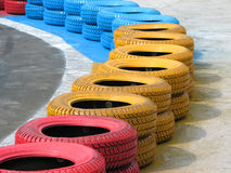 Racetrack fence of old tires Stock Photo