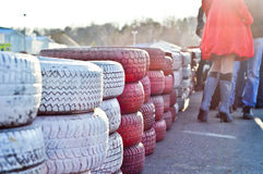 Racetrack fence of white and red of old tires Stock Image