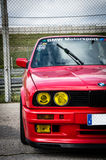 Racetrack's beast. Red BMW 3-series (E30) parked in the paddock of the Jarama racetrack, Spain Royalty Free Stock Images