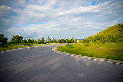 Racetrack straight, road to the mountain with the clear sky. Royalty Free Stock Photography