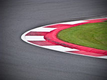 Raceway curve. Red and white curve on the raceway Stock Photo