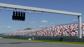Raceway Traffic lights on pit line. Red Raceway Traffic lights switch red to green on pit line stock video footage