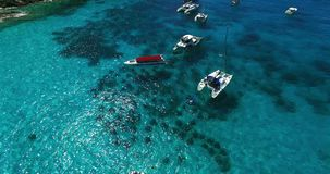 Racha Island Beach. Thailand, Phuket. Yachts , Catamarans and Boats sailing in crrystal clear blue water of ocean