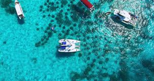 Racha Island Beach. Thailand, Phuket. Yachts , Catamarans and Boats sailing in crrystal clear blue water of ocean. Take. Off from ocean to sky. Catamaran in stock video