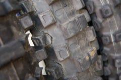 Rache-se, pneu sujo, usado da bicicleta do motocross Foto de Stock Royalty Free