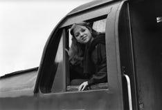 Rachel Sweet. U.S. pop singer, leans out of the cab of a diesel locomotive in Edinburgh, Scotland on October 27, 1978 Royalty Free Stock Image