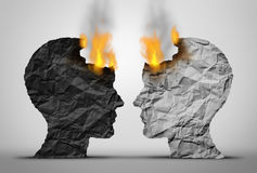Racial Relations Challenge. And social or society race tension as two black and white human heads facing each other in crisis as they both burn as a society and Stock Photography