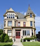 Racine Italianate. This is a Summer picture of the Joseph Miller home in Racine, Wisconsin in Racine County. This three-story cream brick mansion with Stone stock photography