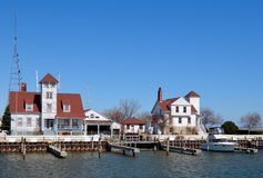 Racine Lighthouse and Life Saving Station. This is a Spring picture of the Lighthouse (left) and Life Saving Station (right) in Racine Harbor on Lake Michigan in royalty free stock image
