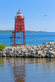 Racine North Breakwater Lighthouse. The Racine, Wisconsin North Breakwater Lighthouse is backed by the lighthouse at Wind Point on the distant horizon stock photo