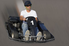 Racing. Man  with go-cart overtaking to the first place position Stock Photo