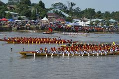 Racing in actions. Regatta or a long boat race competitions in conjunctuion of 45th Sarawak Independence in Malaysia.Sarawak the largest state in Malaysia Royalty Free Stock Photo