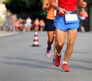 Racing and athletes in sportswear race on the streets Stock Photo