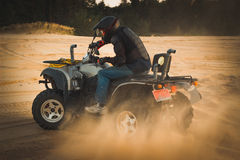 Racing ATV is sand. Royalty Free Stock Image