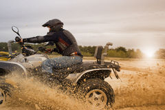 Racing ATV is sand. Royalty Free Stock Photography