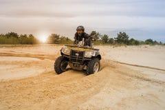 Racing ATV is sand. Royalty Free Stock Photo