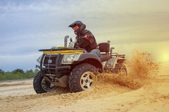 Racing ATV is sand. Racing ATV in the sand in the summer on the prepared track Royalty Free Stock Photo