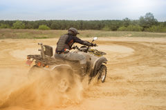Racing ATV is sand. Royalty Free Stock Photography