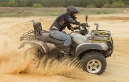 Racing ATV is sand. Royalty Free Stock Image