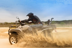 Racing ATV in the sand Royalty Free Stock Images