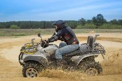 Racing ATV is sand. Stock Image