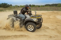Racing ATV is sand. Royalty Free Stock Photos