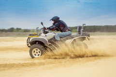 Racing ATV is sand. Royalty Free Stock Images
