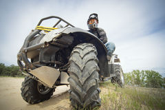 Racing ATV is sand. Stock Photo