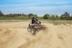 Racing ATV is sand. Stock Photos